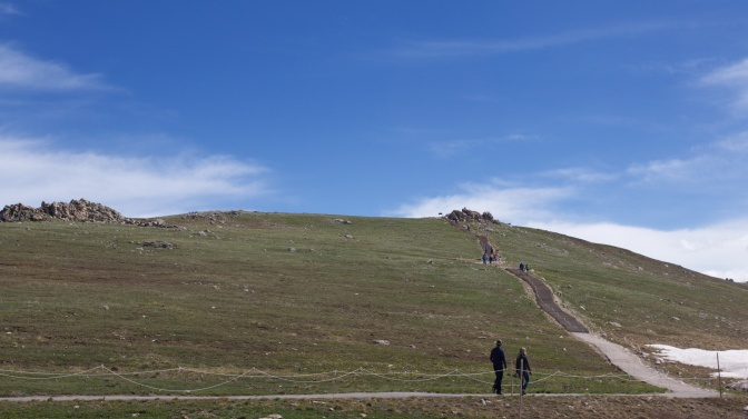 View of Alpine Ridge Trail, with two people in foreground about to ascend steps.