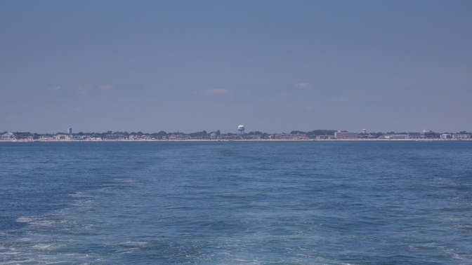 Looking toward coast of Cape May, with water of ocean in foreground.