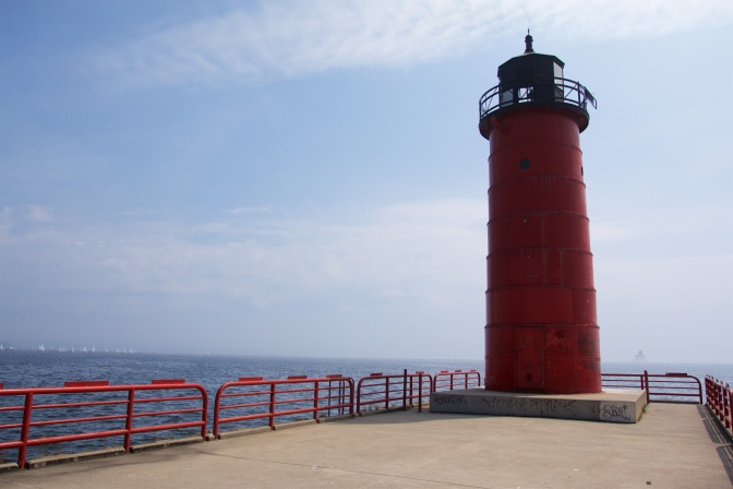 Milwaukee Pierhead Lighthouse, with a red base and black iron top.
