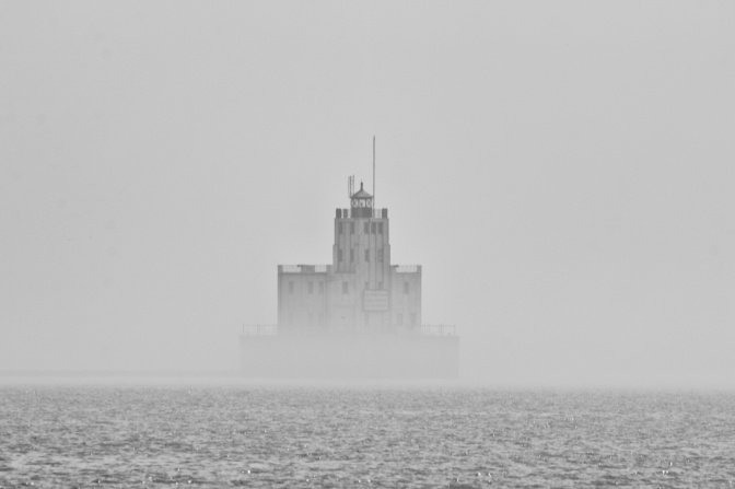 Breakwater Lighthouse, visible through fog.
