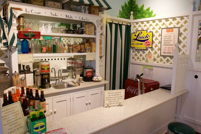 Recreation of a soda fountain from the 1920s, with various bottles and beverages on display.