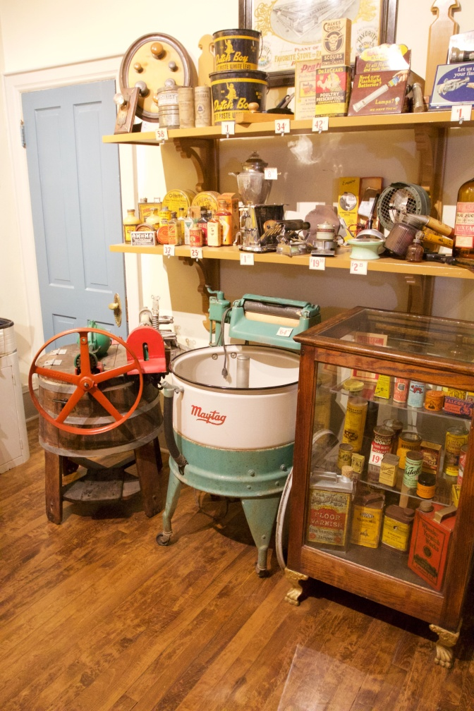 Hardware store, with old time washer and dryer along with old appliances from early 20th century.