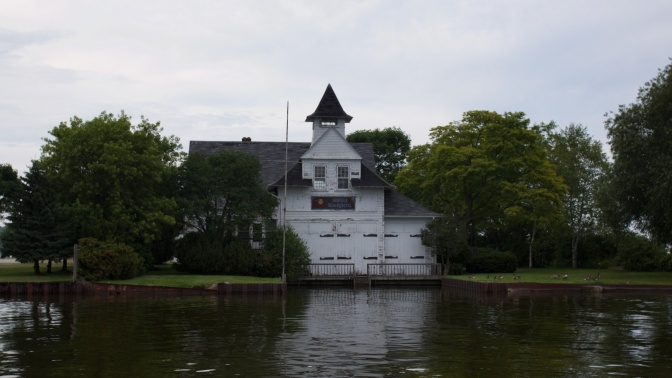 US Life Saving Station, a two-story white building along the water.