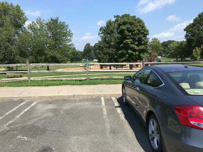 2012 Honda Accord coupe, parked in front of small municipal park.