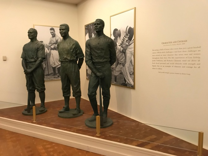 Statues of Lou Gehrig, Jackie Robinson, and Roberto Clemente.
