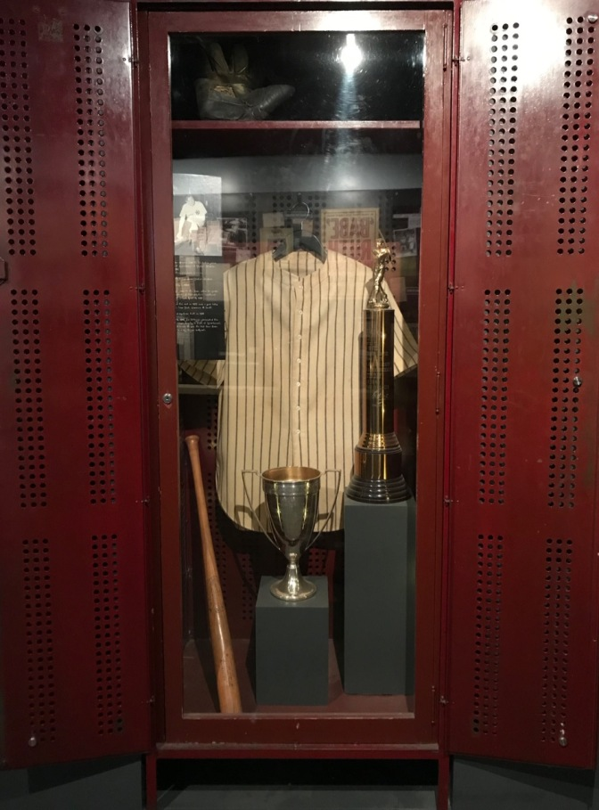 Babe Ruth's locker from Yankee Stadium, with trophies, his glove, his bat, and his jersey.