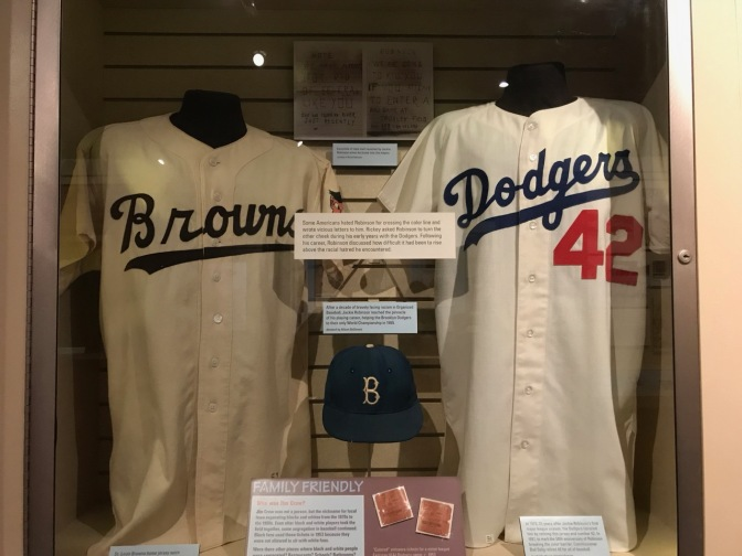 Jerseys of Jackie Robinson, along with his cap.