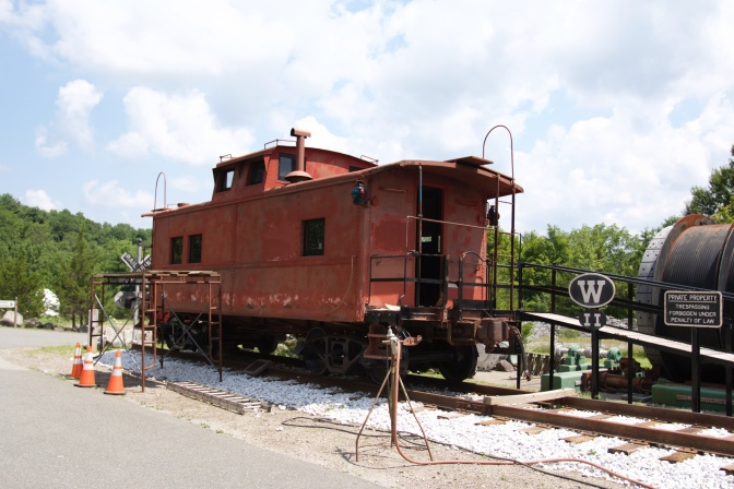 Red caboose in museum yard.