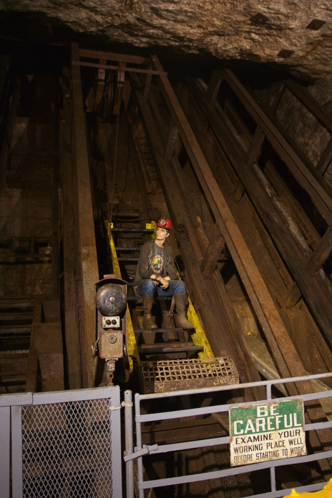 Mine shaft with mannequin on elevator.