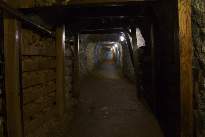 Mine tunnel with wooden bracing.