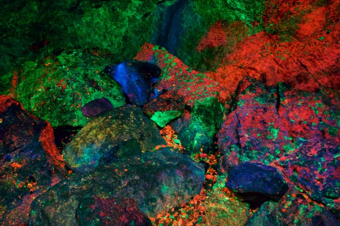 Rocks glowing in fluorescent colors.