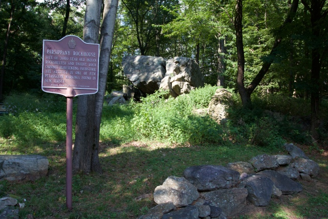 Sign that reads PARSIPPANY ROCKHOUSE. The rock formation is in the background.