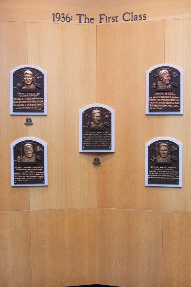 Plaques of five players on wall, with the words 1936: The First Class above it.