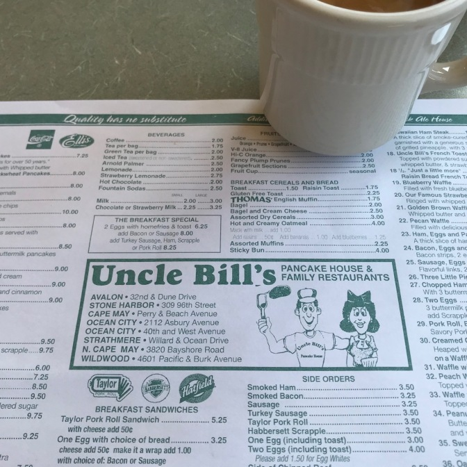 Uncle Bill's Pancake House placemat menu with a white coffee cup.