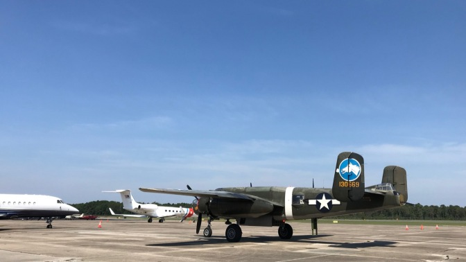 B-25 Mitchell bomber parked on tarmac.