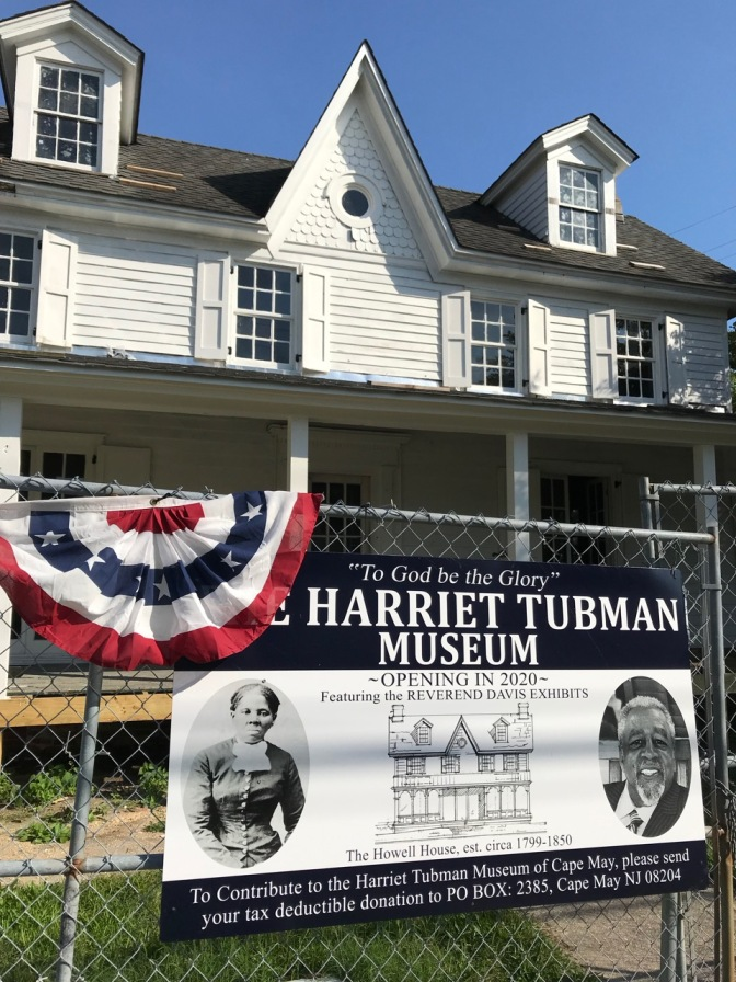 Exterior of white home, with sign in front saying THE HARRIET TUBMAN MUSEUM OPENING IN 2020
