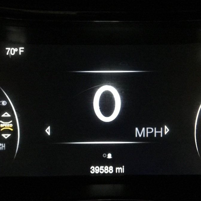 Car odometer that reads 39,588 miles.