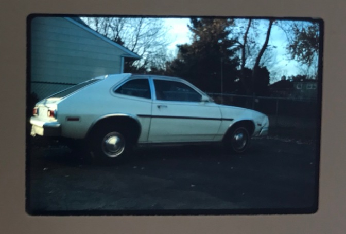 Slide photo of white Ford Pinto.