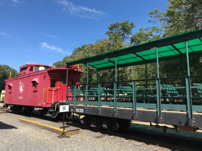 Caboose and train car of railroad.