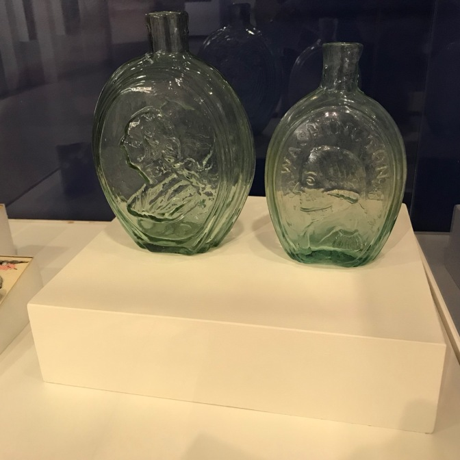 Two glass bottles of George Washington.