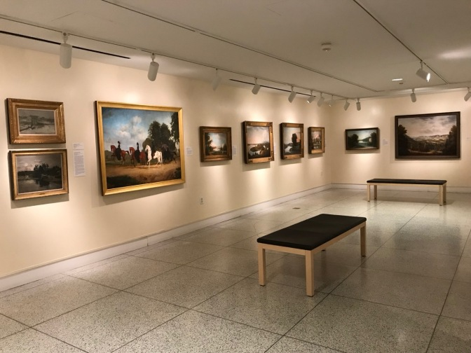 Small art gallery with paintings.