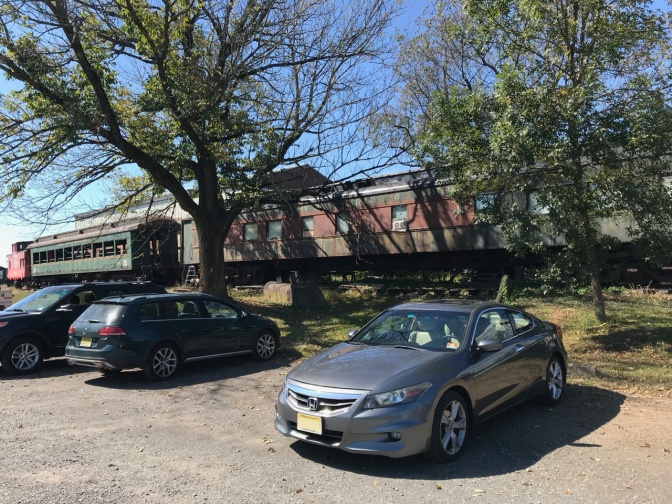 2012 Honda Accord parked in front of railroad cars.
