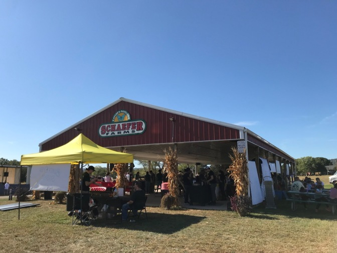 Exterior of pavilion at Schaefer Farms, with a yellow tent in the foreground.