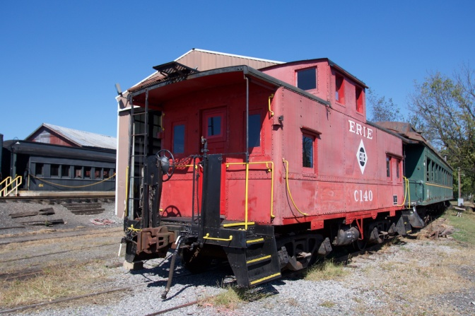 Red caboose at the end of a train.