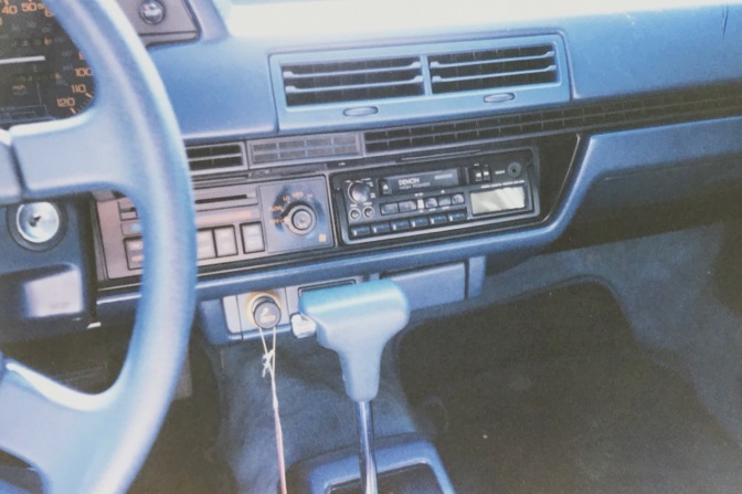 Dashboard of Honda Accord (blue, with black accents).
