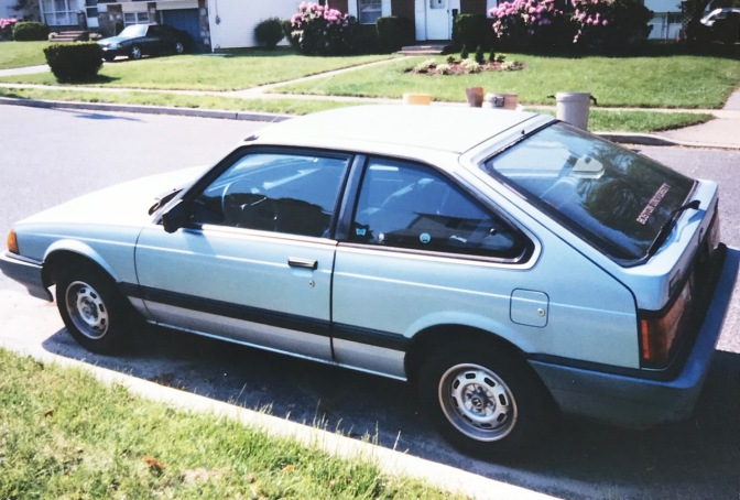 1984 Honda Accord parked along residential street.