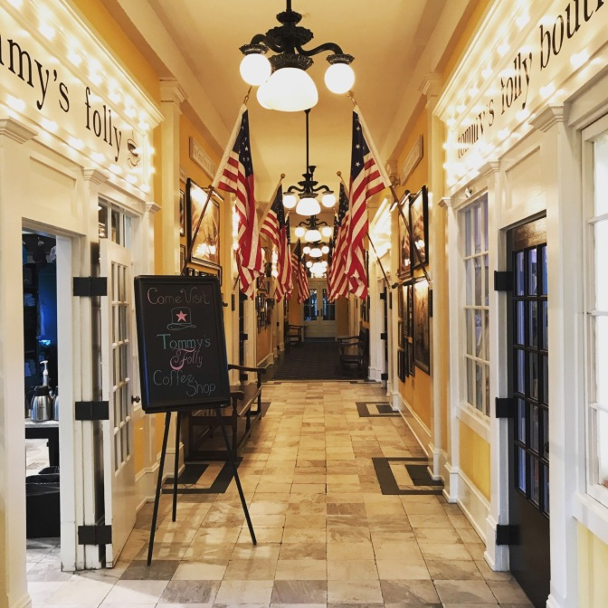Interior hallway of Congress Hall, with flags lining the hallway