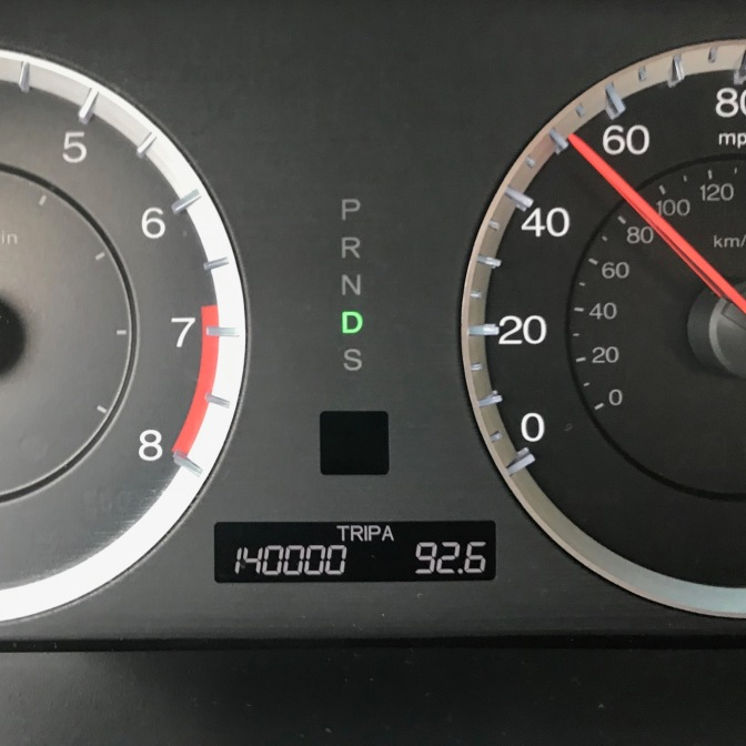 Car odometer that reads 140,000 TRIP A 92.6