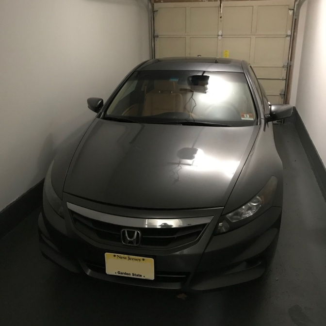2012 Honda Accord in single-car garage.