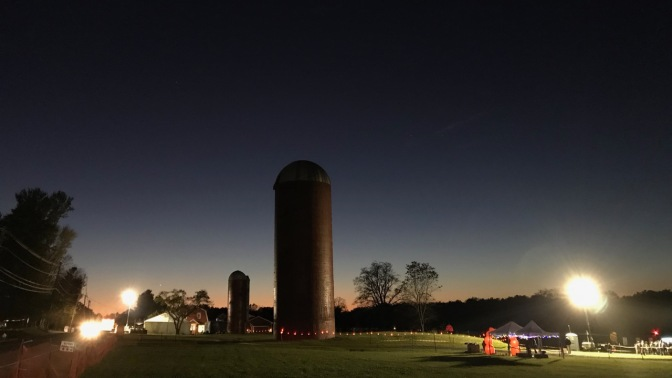 Silos in field at Wagner Farm, with floodlights illuminating the area around it.