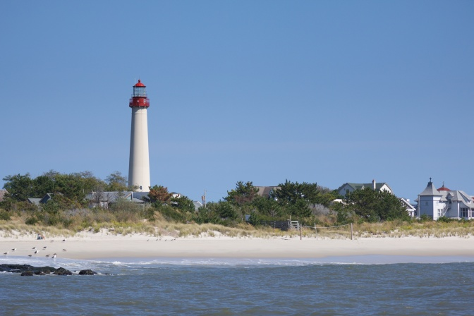 Cape May Lighthouse with beach in foreground.