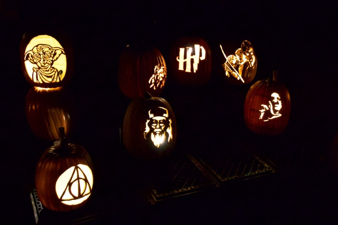 Pumpkins with Harry Potter characters and logos including Dobby, Dumbledore, and Harry, Ron, and Hermione.