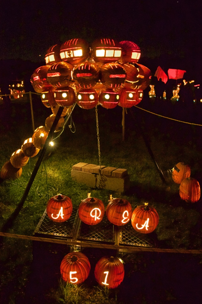 UFO made of pumpkins, with sign on ground (carved into pumpkins) that says AREA 51.