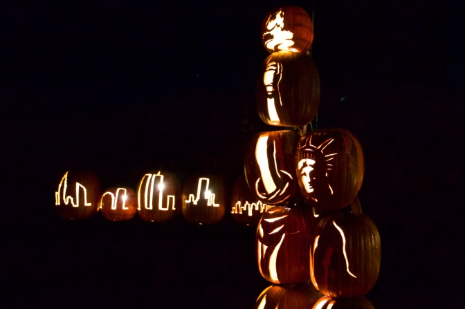 Statue of Liberty with New York Skyline, all carved from pumpkins.
