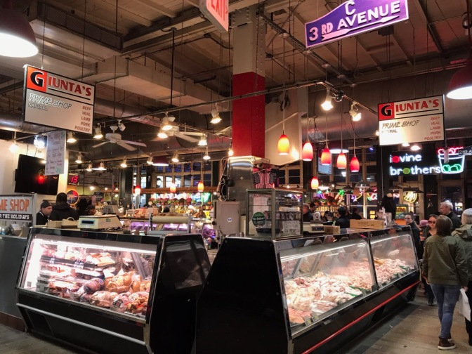 Giunta's Prime Shop butcher market. Blue sign hanging from ceiling says C 3RD AVENUE.