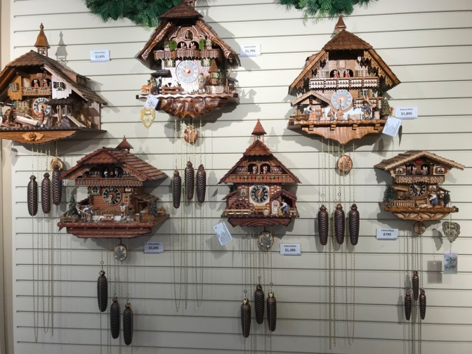 Selection of cuckoo clocks on a wall.