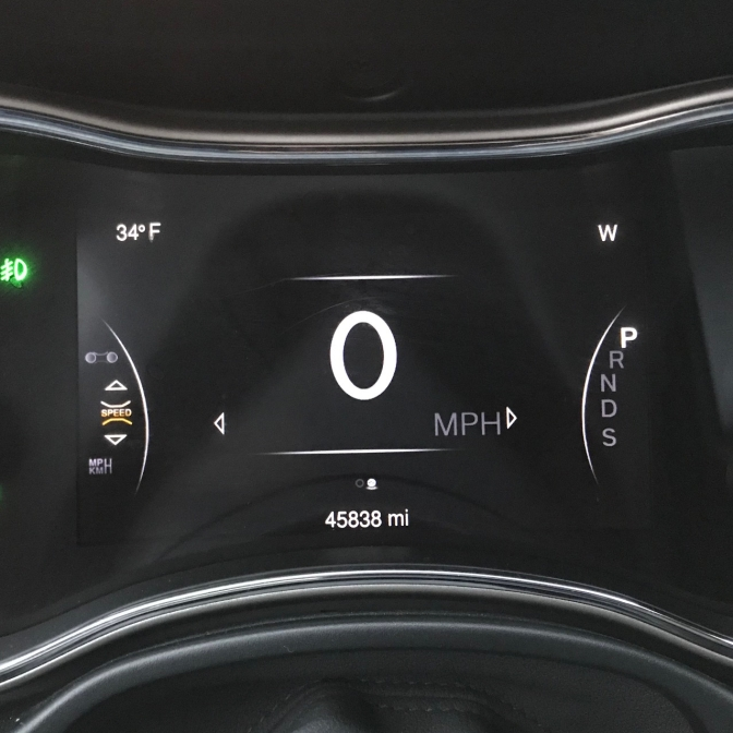 Car odometer reading 45838 miles.