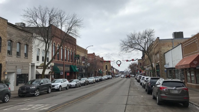 Downtown Hudson, Wisconsin, with brick buildings along both sides of street.