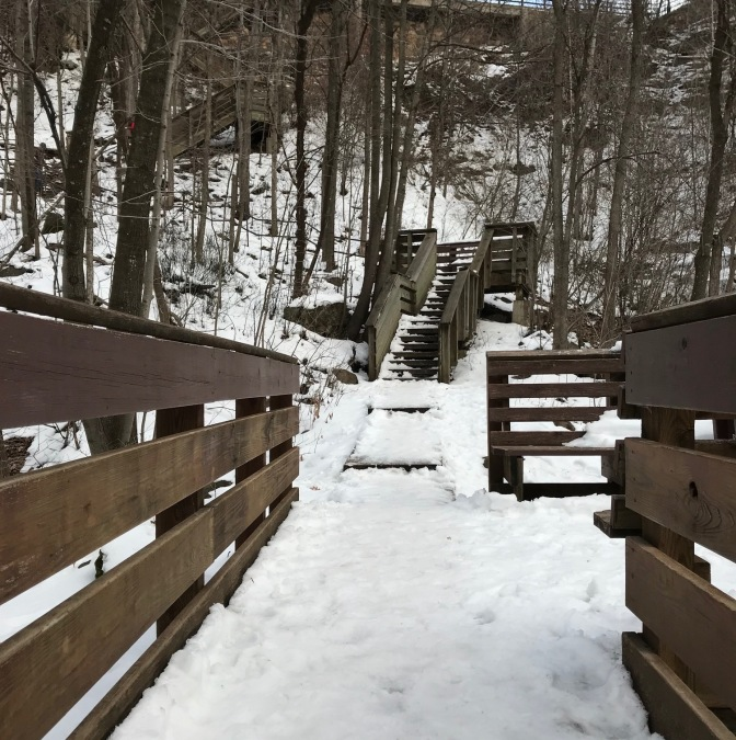 Ice-covered wooden stairs along side of Cascade Falls.