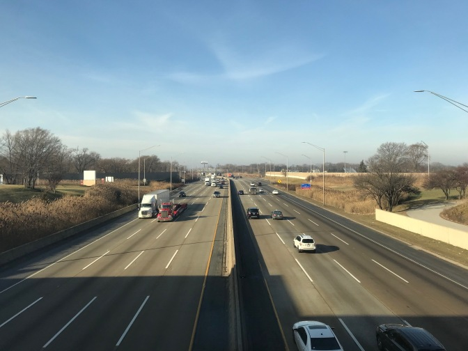 View overlooking I-90 traffic from rest stop in Illinois.