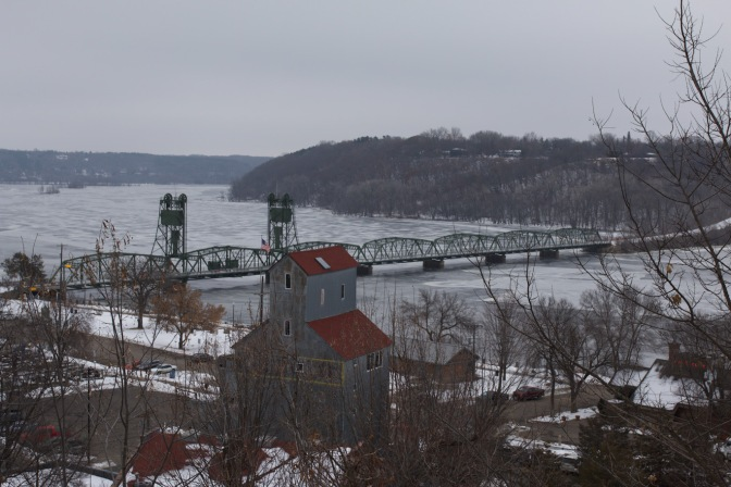 View of St. Croix RIver from top of hill, with Stillwater Lift Bridge on river.