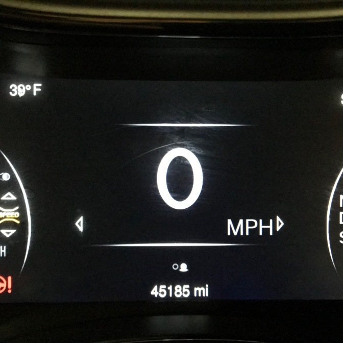 Car odometer reading 45,185 miles.