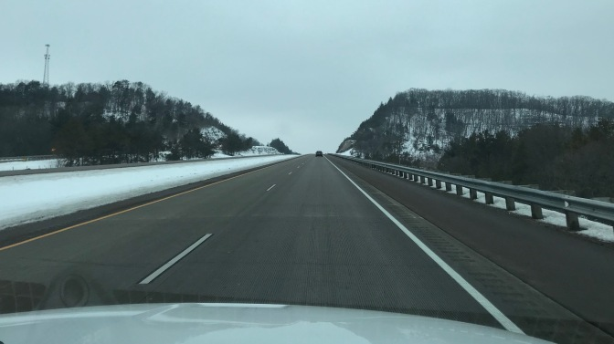 Snow-covered hills along side of I-94 in Wisconsin.