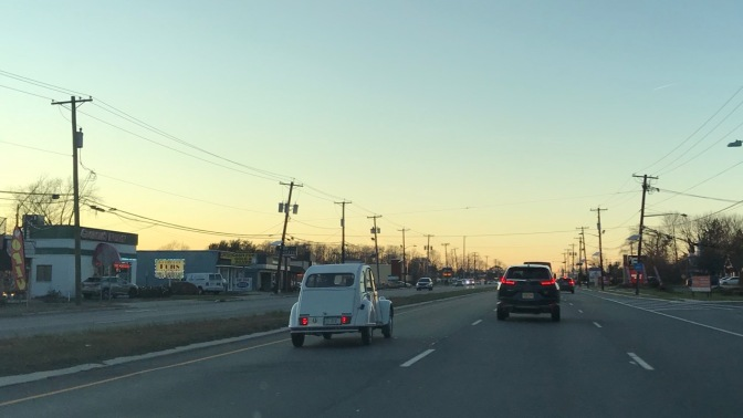 Citroen 2CV in left-hand lane.