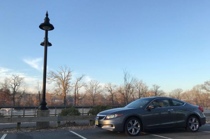 Gray 2012 Honda Accord parked in park along Raritan River.