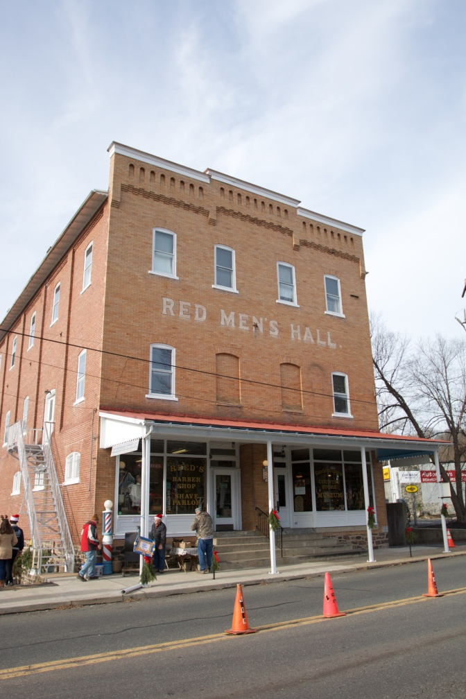 Exterior of Red Men's Hall, a three story brick building.